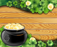 Pot of gold on wooden backgroun Royalty Free Stock Image