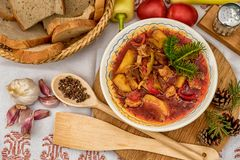 Pot goulash with divas placed on the table of ingredients royalty free stock photography