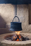 Pot hanging on a chain Stock Photography