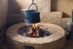 Pot hanging over the fire Royalty Free Stock Image