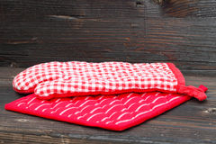 Pot holders and oven mitt Stock Photo