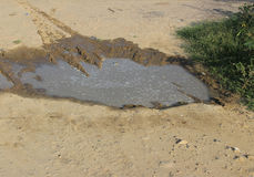 Pot hole. Filled with rain water Royalty Free Stock Image