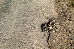 Pot holes in road Stock Photos