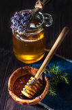Pot of honey with lavender and a spoon for honey Royalty Free Stock Images