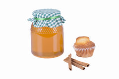 Pot of honey, muffin, and cinnamon Royalty Free Stock Images