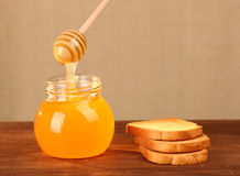 Pot of honey and rusks Stock Image