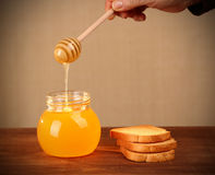Pot of honey and rusks Stock Photography