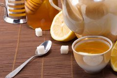 Pot and honey on table Royalty Free Stock Photo