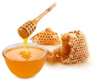 Pot of honey and wooden stick. Stock Photography