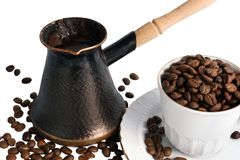 Pot of hot black coffee and cup with beans Stock Photography