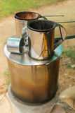 Pot of hot water boiler on wood fueled stove with coffee filter Royalty Free Stock Photos