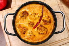 Pot of Indian Gram Flour Dumplings in Yogurt Curry Sauce Stock Photo