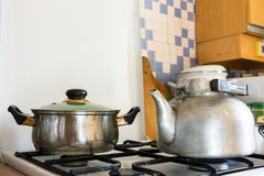 Pot and kettle on a gas stove. 1 Royalty Free Stock Photography