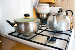 Pot and kettle on a gas stove. 2 Stock Images