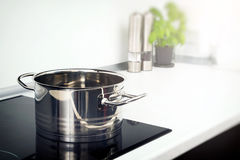 Pot in the kitchen on the induction hob Stock Images