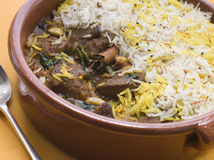 Pot of Lamb Biryani with a spoon Stock Image