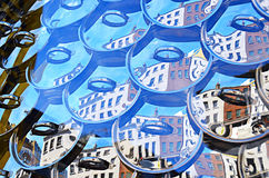 Pot lids in a hanging window display Royalty Free Stock Photo