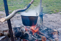 Pot with a meal on a fire Stock Photo