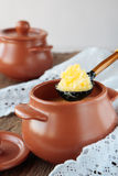 Pot with melted butter Royalty Free Stock Image