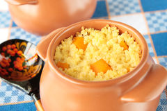 Pot of millet porridge with sliced pumpkin Stock Photos