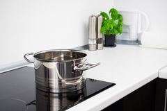Pot in modern kitchen Stock Images