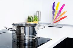 Pot in modern kitchen with induction stove. Stock Photo