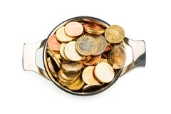 Pot of money. A pressure cooker is filled with euro coins, symbolic photo for grants and subsidies Royalty Free Stock Image