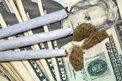 Pot and money up close Stock Image
