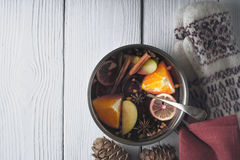 Pot with mulled whine on the white wooden table horizontal Stock Photography