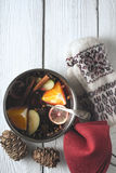 Pot with mulled whine on the white wooden table top view Royalty Free Stock Image