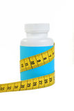 Pot Of Diet Pills On White. Royalty Free Stock Photography