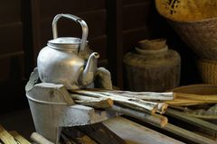 A pot on old stove in rural kitchen. A pot on old stove in rural kitchen, Thailand Royalty Free Stock Photography