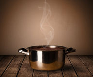Pot on old wooden table Royalty Free Stock Photos