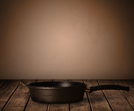 Pot on old wooden table Royalty Free Stock Images