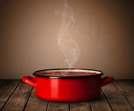 Pot on old wooden table Stock Photos