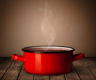 Pot on old wooden table Stock Image