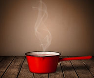 Pot on old wooden table Stock Images