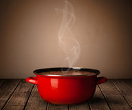 Pot on old wooden table Royalty Free Stock Image