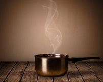 Pot on old wooden table Stock Photo