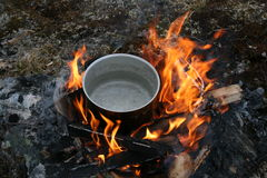 Pot on open wood fire Stock Photography