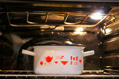 Pot in the oven Stock Image