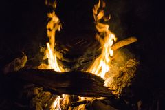 Pot over a campfire at night stock photos