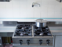 Pot over the stove's gas stainless steel industrial kitchen Stock Photography