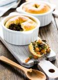 Pot pie in ramekin with vegetables Stock Images