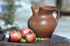 Pot with Pomegranates Royalty Free Stock Images