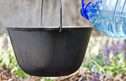 In a pot pour the water for cooking. Stock Photos