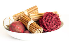 Pot Pourri background. A Collection of pot pourri red wicker balls stacked ontop of each other on a white background Stock Photo