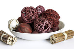 Pot Pourri background. A Collection of pot pourri red wicker balls stacked ontop of each other on a white background Stock Photography
