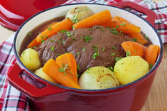 Pot Roast. Bolar roast, or blade roast, pot roasted with potatoes, onions and carrots. A simple, satisfying meal Royalty Free Stock Photos