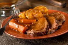 Pot Roast Dinner. A delicious homemade pot roast dinner with potatoes, carrots, and gravy Royalty Free Stock Photos